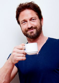 gerard-butler-holding-a-cup